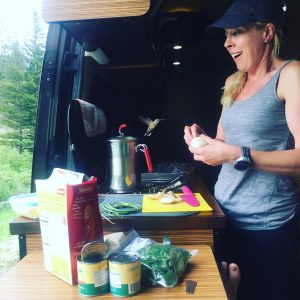 A hummingbird greets Bethany as she prepares dinner at a Rocky Mountain Natl Park overlook.