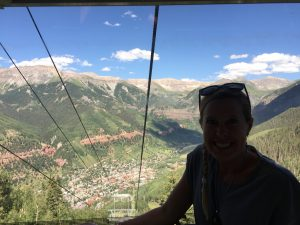 Bethany soaks in the mountain backdrop that envelopes Telluride on the free gondola ride to Mountain Village.