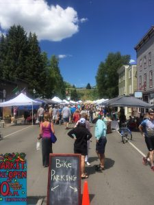 Bethany ponders what to purchase amidst the bounty at the Crested Butte Farmers Market - Every Sunday.