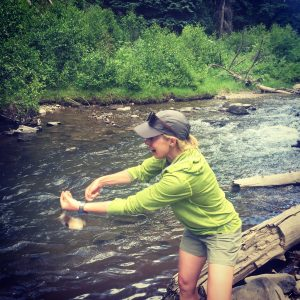 Bethany catches her first Cut-Bow Trout with Andrew from San Miguel Anglers.